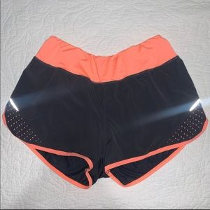 black and coral pink workout shorts